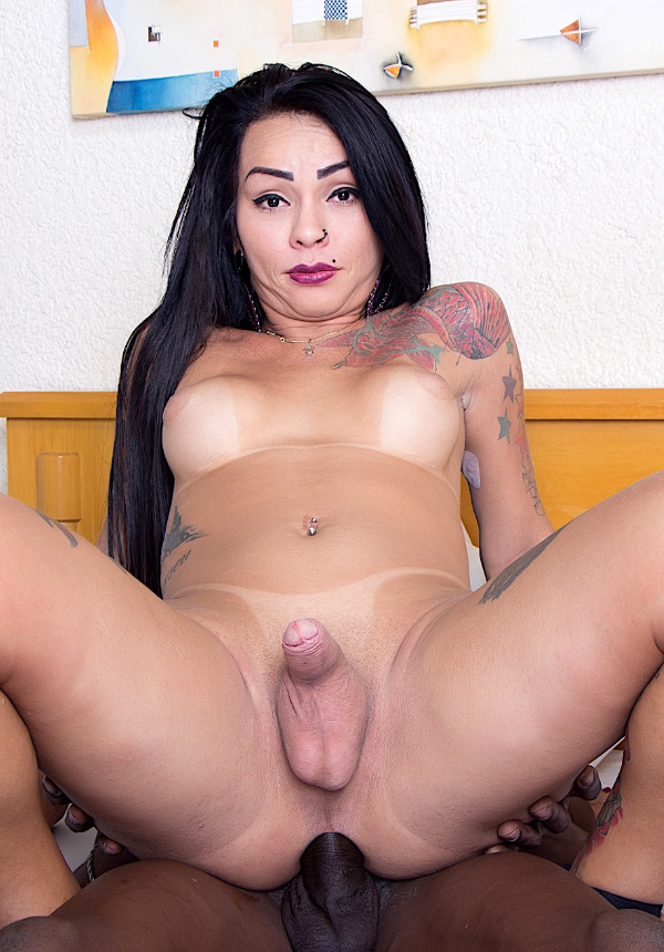 Sexy tranny Nicolly Pantoja gets her asshole filled with a black dick